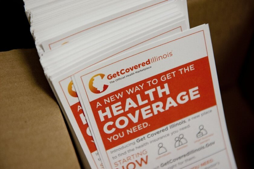 Fliers promoting the Get Covered Illinois health insurance marketplace sit in a box at the Bureau County Health Department offices in Princeton, Ill., on Dec. 18. The Affordable Care Act's mandate for all Americans to have health insurance has highlighted how much insurance policies have become the gateway to medical care.