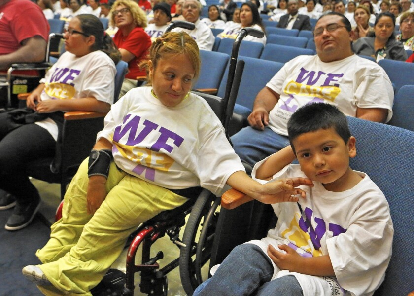 Attending the L.A. County supervisors meeting to support better wages for in-home care workers are Elizabeth Arvizu, center, her son Juan Pablo Lopez, right, husband, Jose Lopez, rear right and daughter Dulce Lopez.