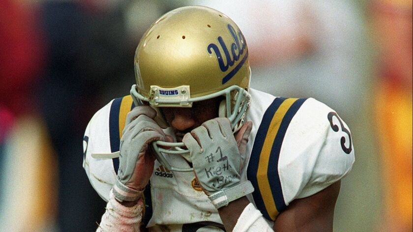 UCLA receiver Freddie Mitchell after dropping a pass in the second quarter, one of two consecutive drops, during game against USC at the Coliseum on Saturday, Nov.20, 1999. USC won 17-7, breaking an eight game losing streak to their crosstown rivals.