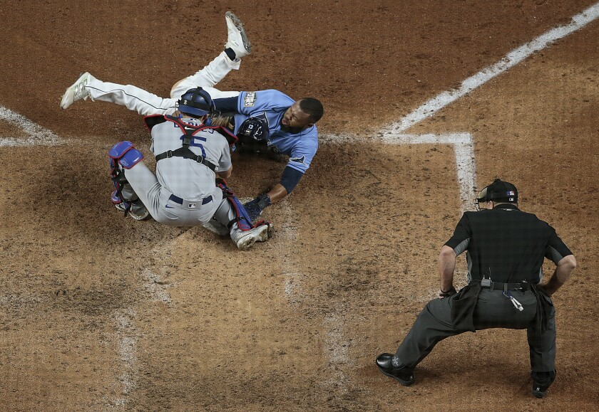Tampa Bay Rays baserunner Manuel Margot is tagged out by Dodgers catcher Austin Barnes.