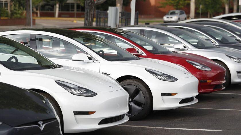 Tesla Model 3 sedans outside a Tesla showroom in Littleton, Colo., in July.