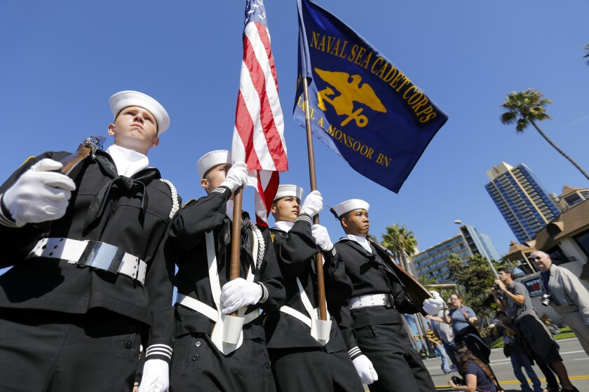 Members of the Navy Sea Cadet Corps makes its way along Harbor Drive during the 31st annual San Diego Veterans Day Parade.