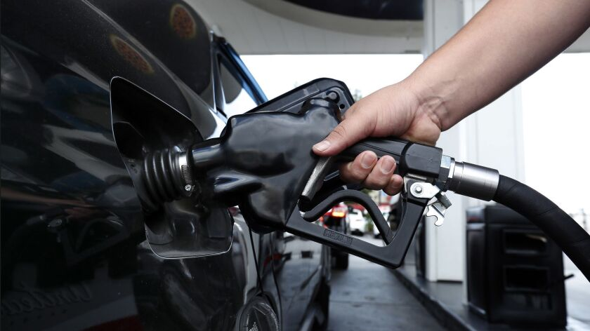 A motorist fills up his tank at a gas station in Van Nuys.