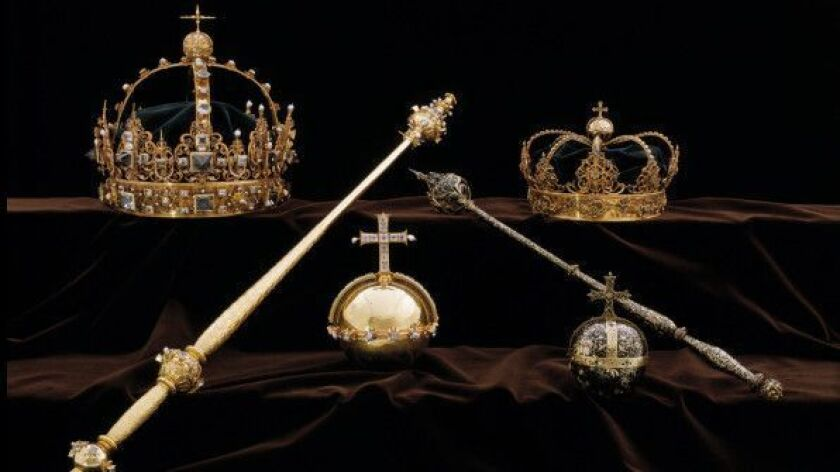 Swedish royal funeral regalia, including gold burial crowns belonging to King Karl IX, top left, and his wife, Queen Kristina, top right, that were on display. Robbers nabbed two 17th-century royal crowns and an orb from a Swedish cathedral on Tuesday.