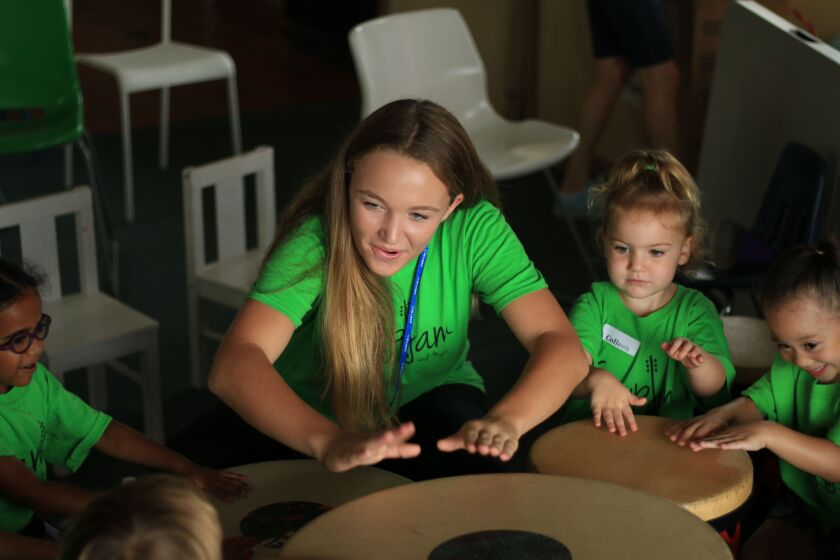 Camp Jam volunteer Emma Cochran works at a music therapy camp for youths with special needs.
