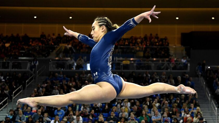 LOS ANGELES, CALIFORNIA MARCH 10, 2019-Katelyn Ohas competes on the beam against Stanford at Pauley