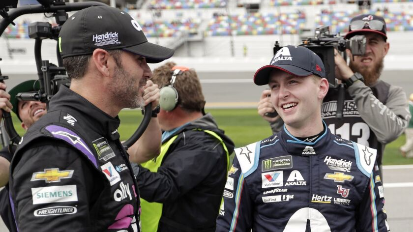William Byron, right, is congratulated by Jimmie Johnson, left, after winning the pole position Sunday for the Daytona 500.