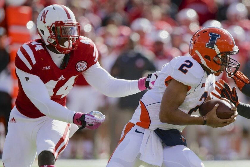 FILE - In this Oct. 5, 2013, file photo, Nebraska defensive end Randy Gregory (44) pursues and later sacks Illinois quarterback Nathan Scheelhaase (2) in an NCAA college football game in Lincoln, Neb. Randy Gregory knows there's more to playing defensive end than just chasing down quarterbacks. A sack total that jumped off the stat sheet last season established him as a possible high draft pick for 2015. The Nebraska junior went into the start of preseason practice Monday, Aug. 4, 2014, with the objective of becoming a complete player. (AP Photo/Nati Harnik, File)