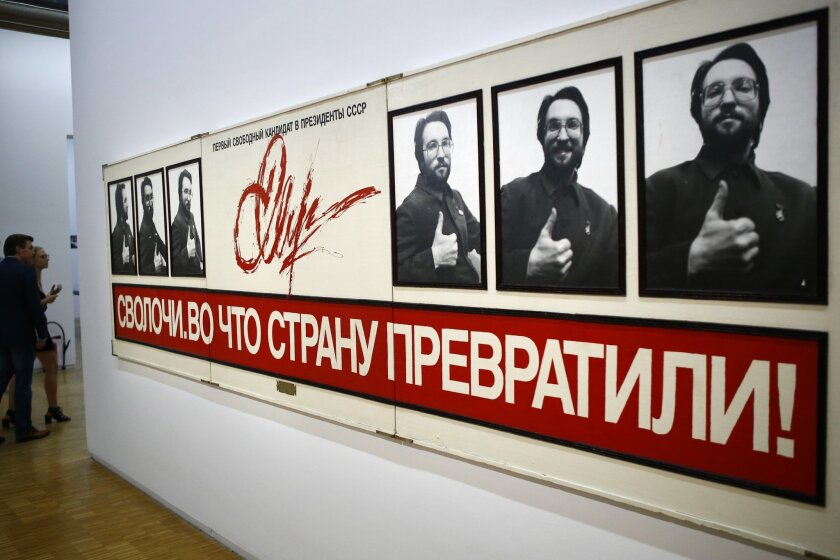 """In this photo dated Monday, Sept. 12, 2016 """"Campagne Presidentielle, 1988"""" by Sergei Mironenko (1959) is displayed as part of the presentation of the Kollektsia exhibition dedicated to Russian contemporary art at Beaubourg Museum in Paris, France. One of the richest oligarchs in Russia, Vladimir Potanin, is donating over 250 works of Russian and Soviet art to France national modern art museum, the Pompidou Center, to promote cultural understanding. The exhibition runs through Sept. 14, 2016 to March 27, 2017. (AP Photo/Francois Mori)"""