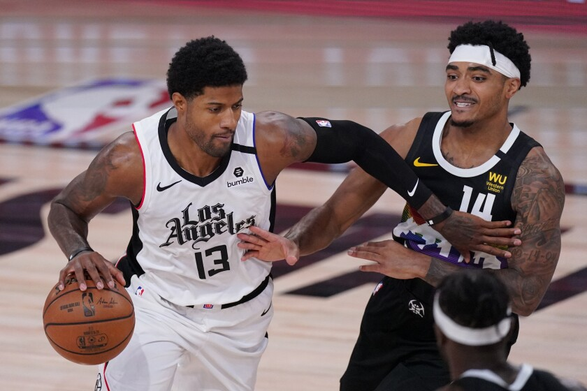 The Clippers' Paul George drives past the Denver Nuggets' Gary Harris.