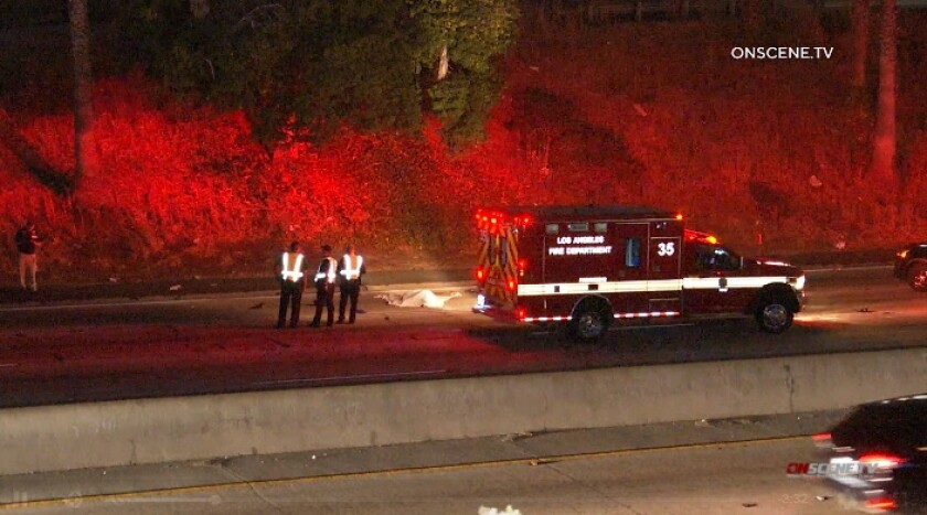 Paramedics respond to the 101 Freeway in Hollywood where a man jumped or fell into traffic late Tuesday.
