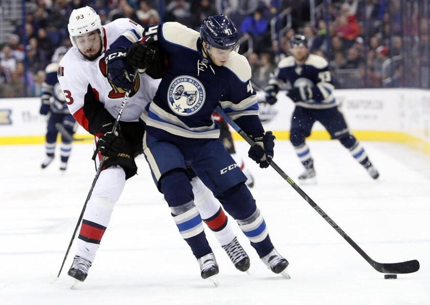 Columbus Blue Jackets' Alexander Wennberg, right, of Sweden, brings the puck up the ice as Ottawa Senators' Mika Zibanejad, also of Sweden, defends during the second period of an NHL hockey game Saturday, Feb. 13, 2016, in Columbus, Ohio. (AP Photo/Jay LaPrete)