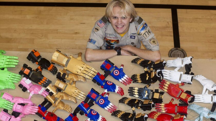 Local 15-year-old Evan Wright displays the end result of his Eagle Scout service project — 40 prosthetic hands for kids ages 4-10. After using a 3D printer to create the pieces, Evan assembled a group of volunteers to put them together.