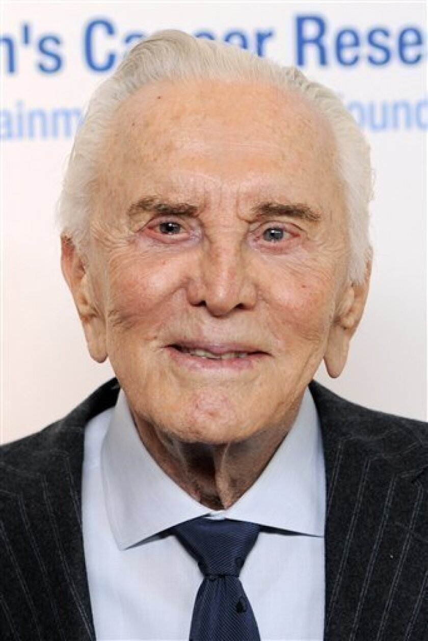 """FILE - In this Feb. 10, 2011 file photo, actor Kirk Douglas arrives at the annual """"An Unforgettable Evening"""" event benefiting the Entertainment Industry Foundation's Women's Cancer Research Fund, in Beverly Hills, Calif. (AP Photo/Chris Pizzello, file)"""