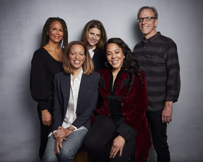 "Sil Lai Abrams, from back left, director Amy Ziering, director Kirby Dick, Drew Dixon, bottom left, and Sheri Hines pose for a portrait to promote the film ""On the Record"" at the Music Lodge during the Sundance Film Festival on Sunday, Jan. 26, 2020, in Park City, Utah. (Photo by Taylor Jewell/Invision/AP)"