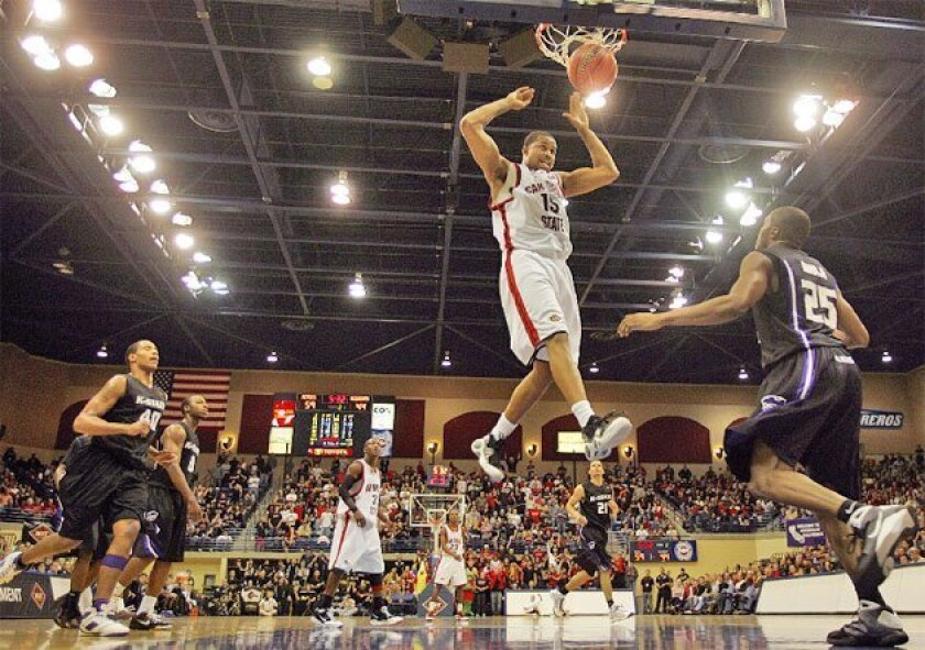 Senior forward Kyle Spain's slam is indicative of SDSU's slamming of Kansas State in the second-round NIT game. (K.C. Alfred / Union-Tribune)