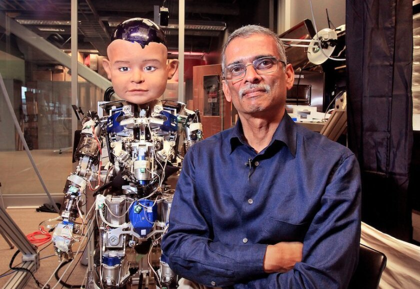 Ramesh Rao, director of the UCSD division of Calit2, stands next to the experimental robot Diego-San.