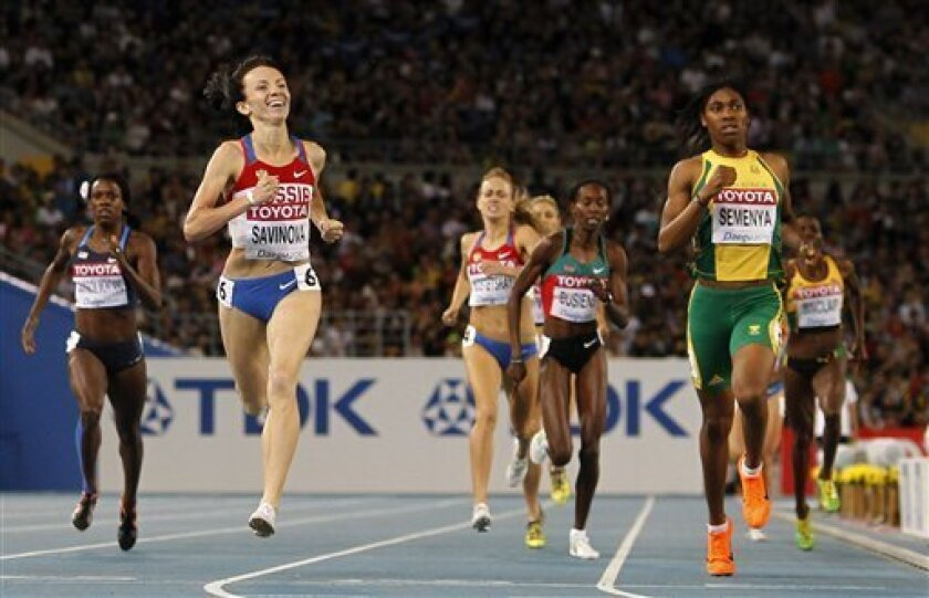 Russia's Mariya Savinova, second from left, crosses the finish line to win ahead of South Africa's Caster Semenya, right, in the Women's 800m final at the World Athletics Championships in Daegu, South Korea, Sunday, Sept. 4, 2011. (AP Photo/Anja Niedringhaus)