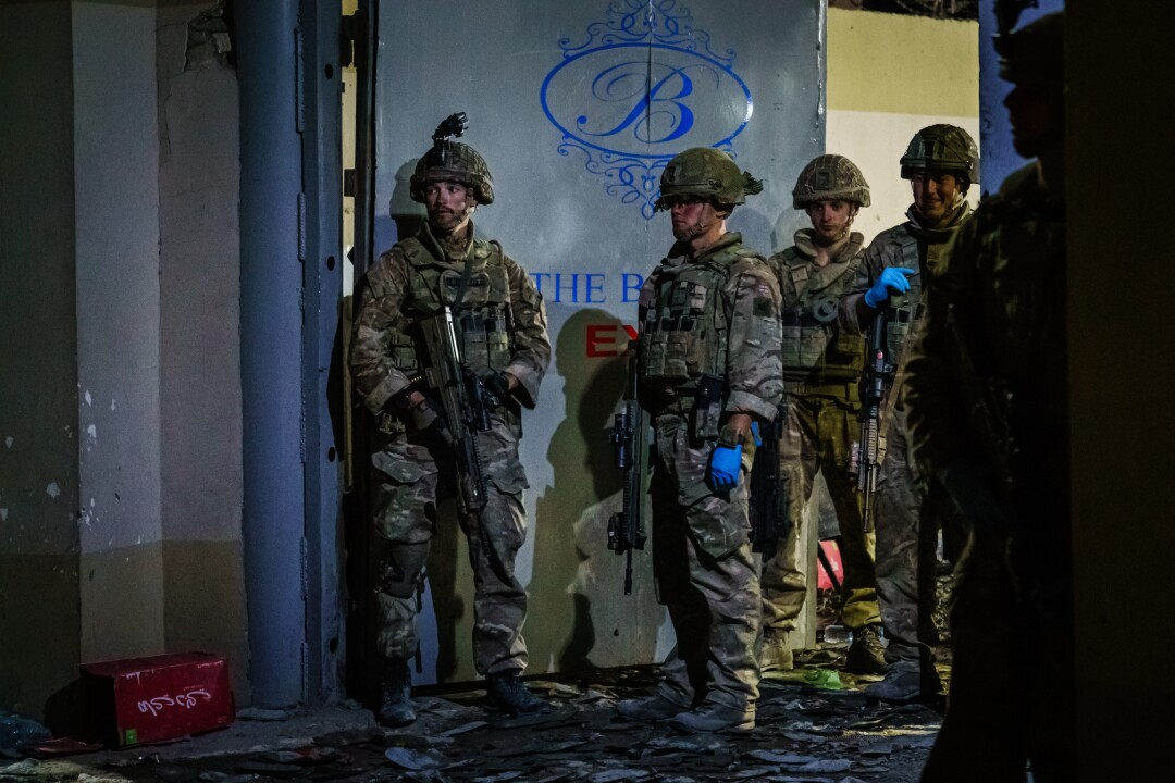 British soldiers secure the perimeter of the Baron Hotel, the site of one of Thursday's bombings in Kabul.