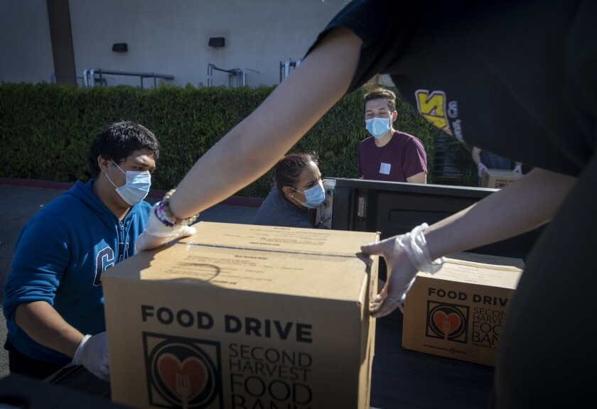 Restaurant workers who had been laid off were hired as temporary employees at Second Harvest Food Bank of Orange County.