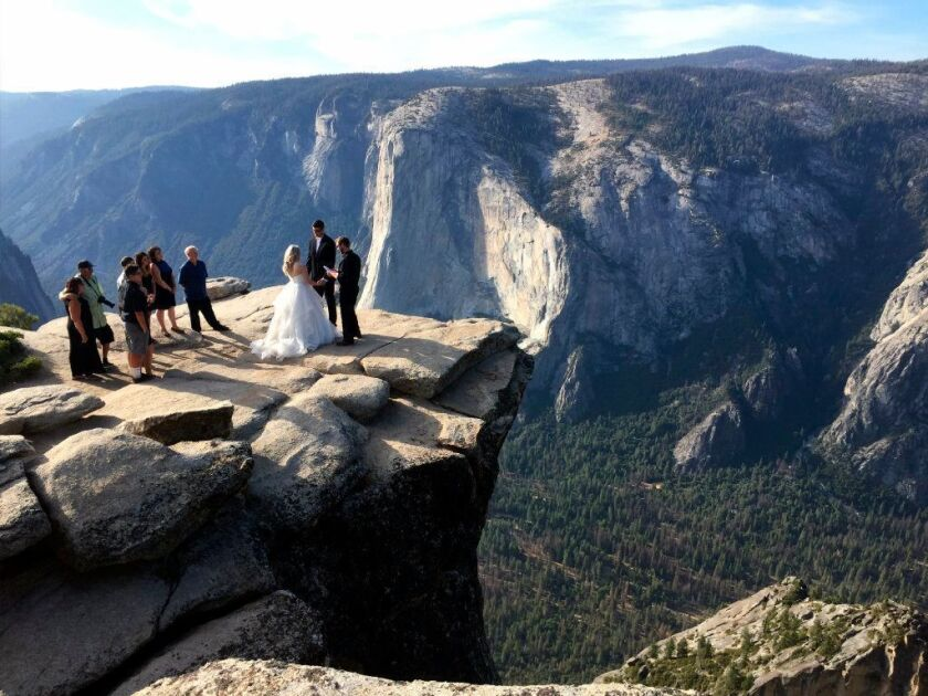 Park rangers recovered the bodies of two people who fell from the popular Yosemite overlook after working to reach them for hours, a park official said Friday, Oct. 26, 2018.