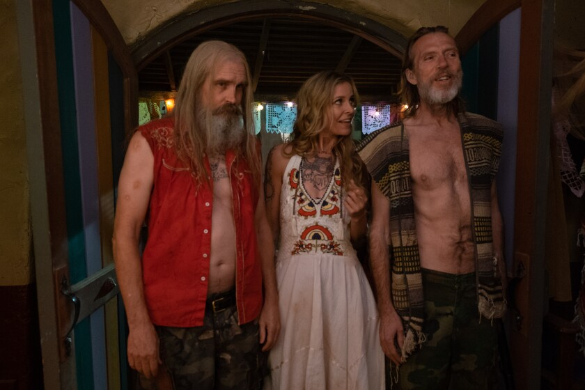 "Bill Moseley, from left, Sheri Moon Zombie and Richard Brake in ""3 From Hell."""