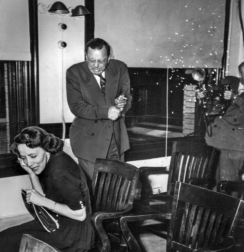 July 29, 1948: Doris Mae Normandine, attorney Werner O. Graf and a Los Angeles Examiner photographer