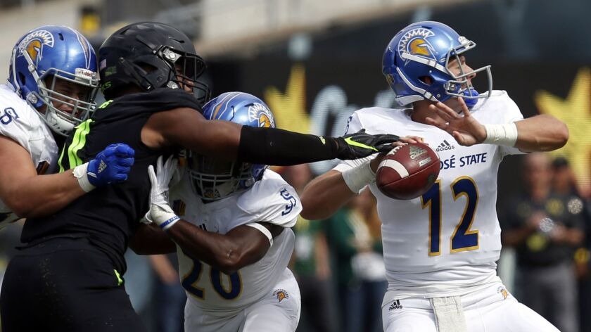 Oregon linebacker Justin Hollins (11) nearly gets a hand on the ball as San Jose State quarterback J