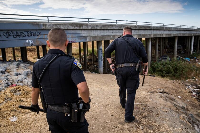 STOCKTON CA OCTOBER 2, 2018 -- Stockton Police Collaborative Court Officer Jason Digiulio, right, a