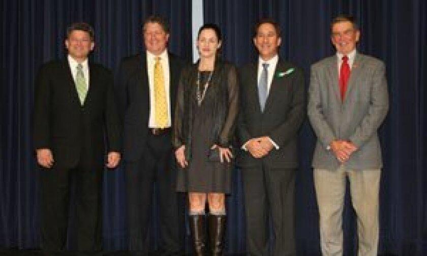 The DMUSD board Scott Wooden, President Doug Rafner, Clerk Kristin Gibson, new member Alan Kholos and Doug Perkins.