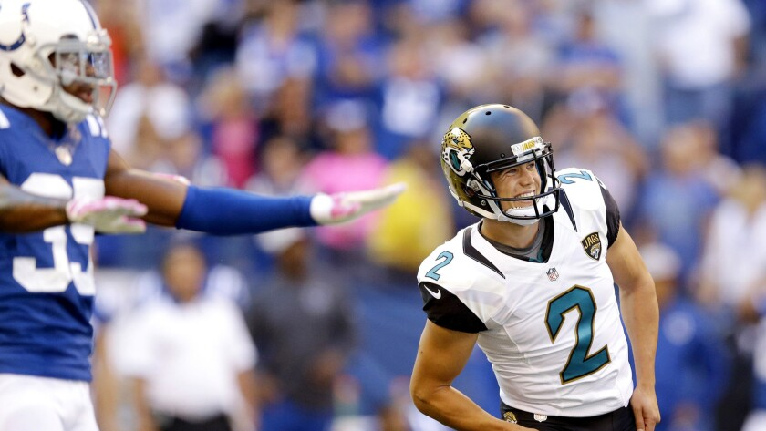 Jaguars kicker Jason Myers (2) and Colts defender Josh Thomas reacts as a potential game-winning field goal sails wide right Sunday.