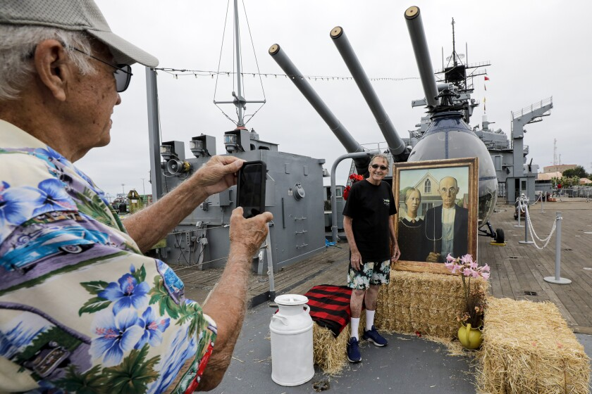 Iowans and their guests having lunch at the 119th annual Iowa Picnic held on the deck of the battleship Iowa on Saturday in San Pedro.