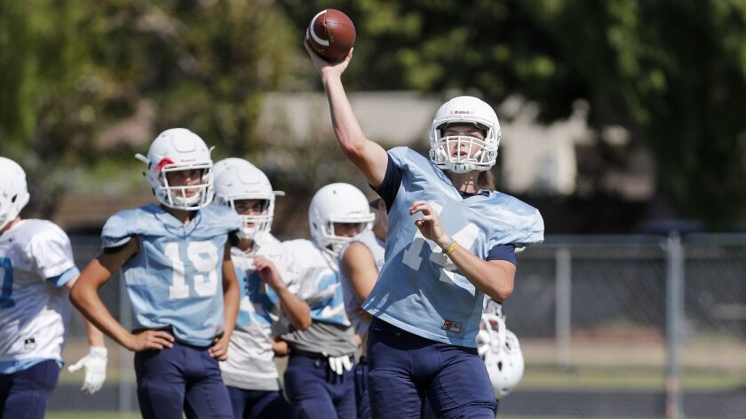Corona del Mar High quarterback Ethan Garbers makes a pass during practice on Wednesday in Newport B