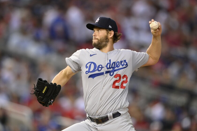 Los Angeles Dodgers starting pitcher Clayton Kershaw delivers during the fourth inning of a baseball game against the Washington Nationals, Saturday, July 3, 2021, in Washington. (AP Photo/Nick Wass)