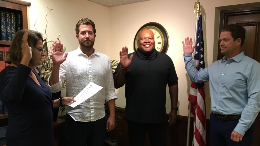 From left, Ann Kerr Bache swears in Rick Dagon, Tony Harris and James Rudolph as La Jolla Town Council trustees June 11.