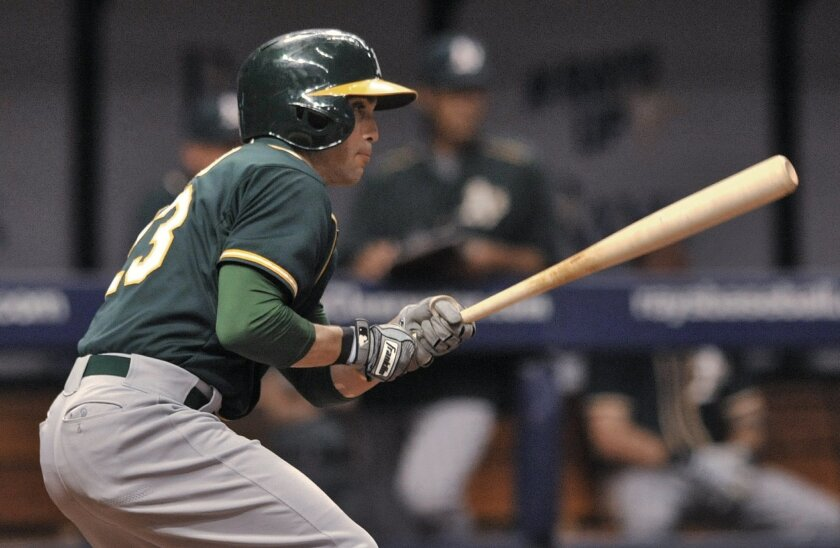 Oakland Athletics' Sam Fuld watches his bases-loaded single off Tampa Bay Rays reliever Xavier Cedeno during the sixth inning of a baseball game Saturday, May 23, 2015, in St. Petersburg, Fla. (AP Photo/Steve Nesius)