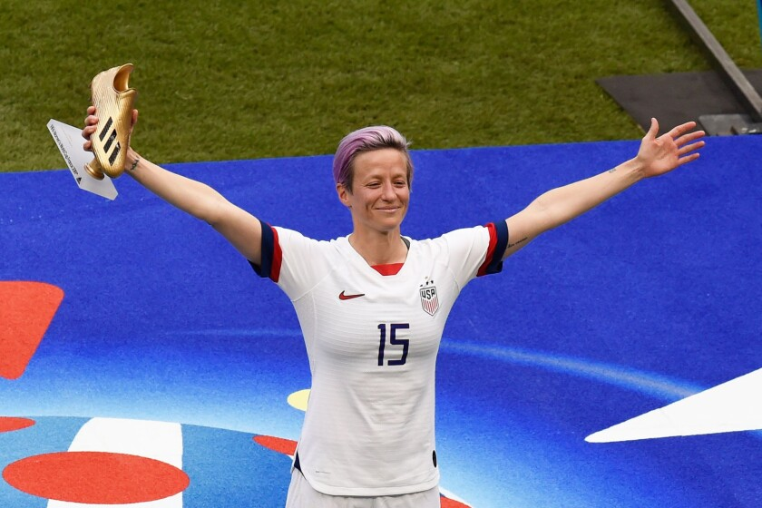 Megan Rapinoe poses with the Golden Boot after scoring the most goals in the Women's World Cup. She also won the Golden Ball as the best player.