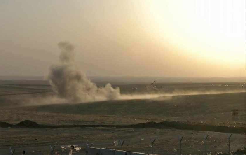 Smoke rises from airstrikes targeting Islamic State militants near the city of Erbil in northern Iraq on Friday.