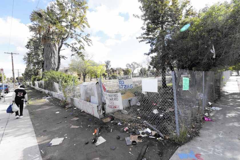 The long-vacant lot at 94th Street and Broadway in South L.A. is strewn with trash after grocer Numero Uno backed out of a deal to add a store there.