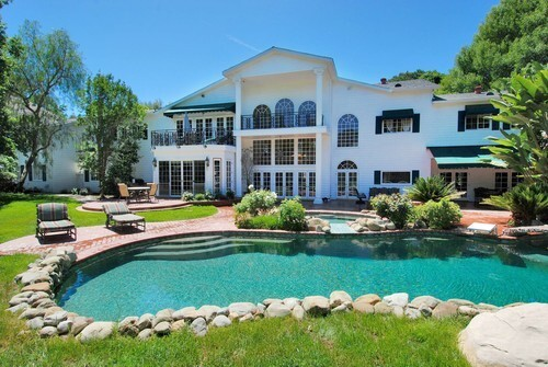 """Actor David Hasselhoff, a judge on the NBC reality hit """"America's Got Talent,"""" has listed his longtime family home in Encino at $4,195,000. The 8,947-square-foot Southern Colonial, with five bedrooms and five bathrooms, sits on nearly 1 1/2 acres."""