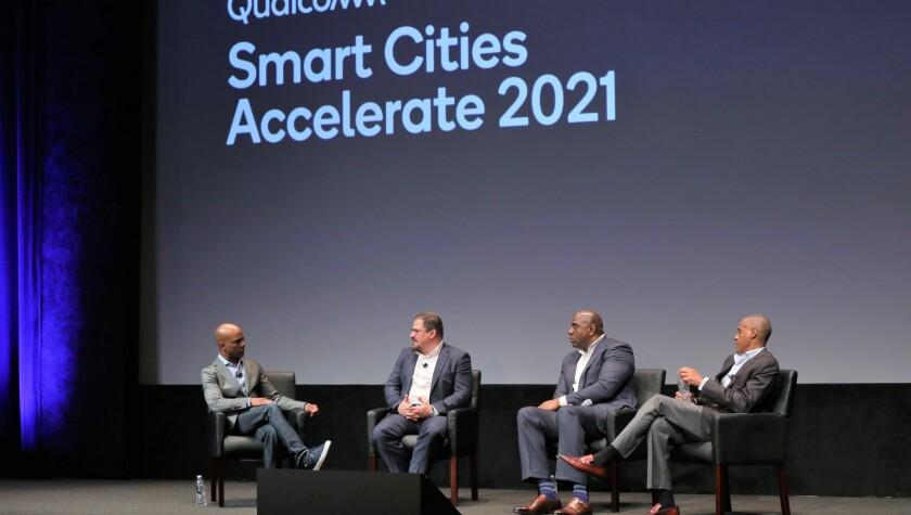 From left, CNBC's Jon Fortt, Qualcomm CEO Cristiano Amon, Magic Johnson and Jim Reynolds, JLC Infrastructure.
