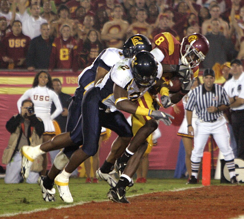 California's Bernard Hicks (2), playing against USC in 2006 at the Coliseum, says in a lawsuit that he sustained multiple concussions playing for the Golden Bears.
