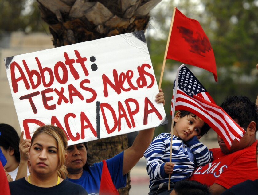 Immigration advocates rally outside the federal courthouse in Brownsville, Texas, last month after a judge issued a stay of President Obama's executive action.