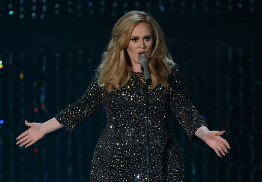 """British singer Adele, shown performing in Hollywood in 2013, is on pace to sell close to 3 million copies of her third album, """"25,"""" which came out Friday."""