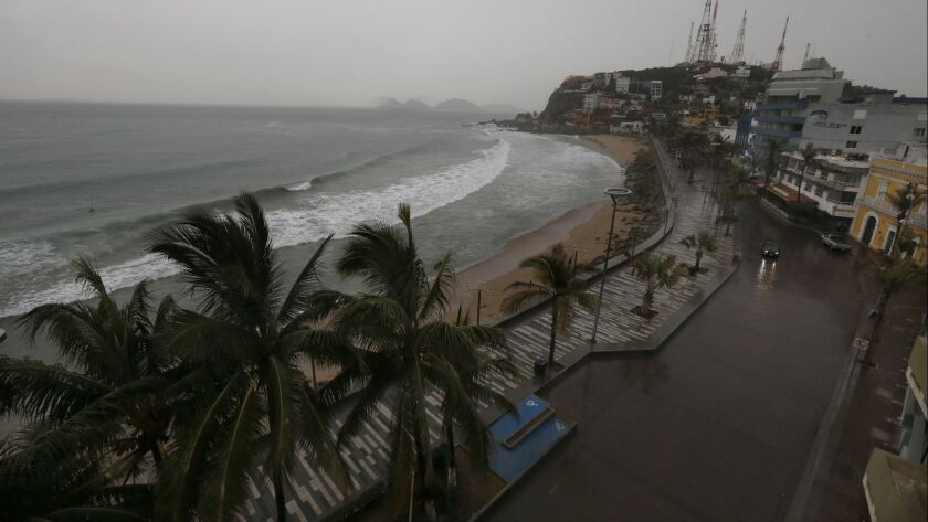 Rain began fall over Mazatlan's empty beaches as Hurricane Willa approached Tuesday evening. The hurricane hit land south of the Mexican resort town as a Category 3 storm.