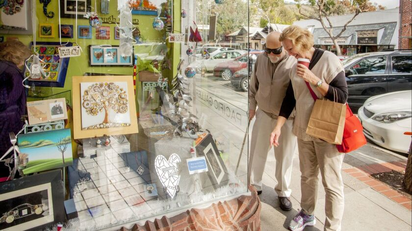 Sharon and David Richards window shop at Pacific Gallery on Forest Avenue, Laguna Beach on Small Bus