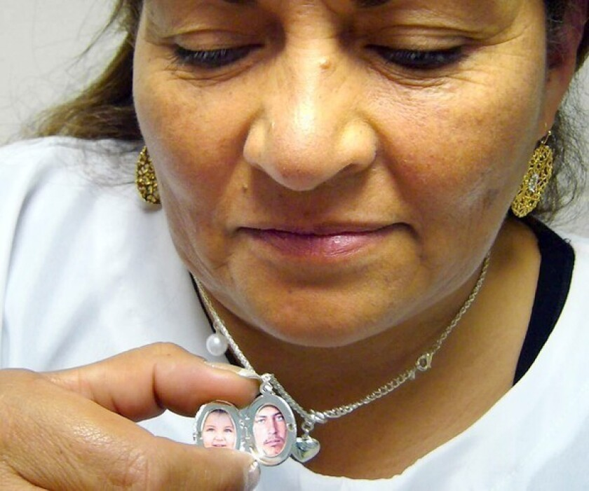 Luz Marina Bernal has a photo of her son Leonardo Porros, in her locket. Porros was lured by a false promise of work and then killed by Colombian soldiers who tagged him as a terrorist slain in combat.