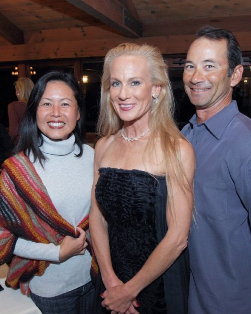 Aces Tennis League founder and director Shelley Susman (center) at the Nov. 21 award ceremony and charity event with Morgan Run player Thanh Huyen and Woody Yocum, Lomas Santa Fe Tennis Club tennis director. Photo/Jon Clark
