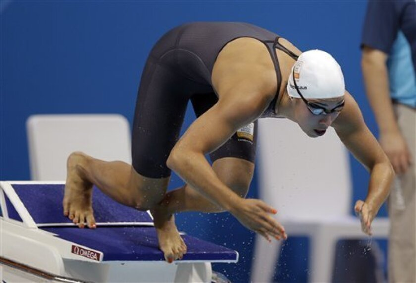 Netherlands' Ranomi Kromowidjojo competes in a 50-meter freestyle swimming heat at the Aquatics Centre in the Olympic Park during the 2012 Summer Olympics in London, Friday, Aug. 3, 2012. (AP Photo/Matt Slocum)