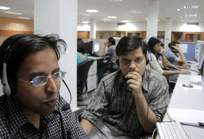Many U.S. businesses use overseas call centers, such as this one in India, for customer service. Is it safe to give your personal information to workers abroad?